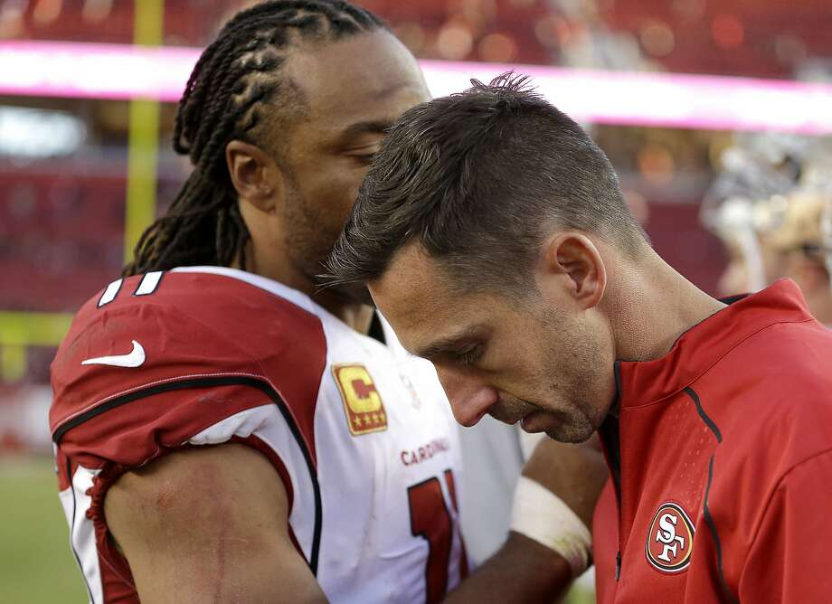 Coach Kyle Shanahan, right, talks with Arizona's Larry Fitzgerald after Sunday's loss left his 49ers winless at 0-9. Photo: Ben Margot, Associated Press