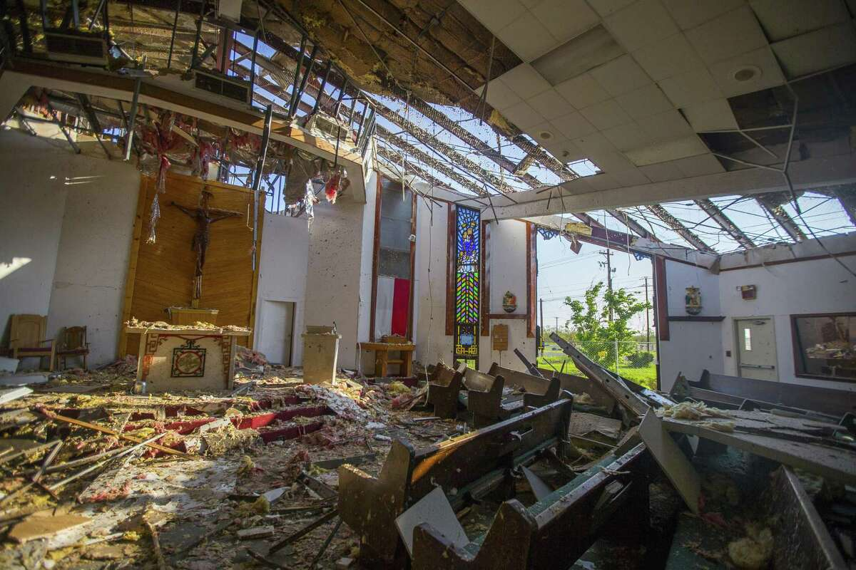 Father John Tran Nguyen stands inside the destroyed building of St. Peter's Catholic Church in Rockport in this Sept. 15 photo. It will cost more and take longer to rebuild after Hurricane Harvey because of a construction labor shortage that is only being made worse by the nation's broken immigration policies, according to a state builders association.
