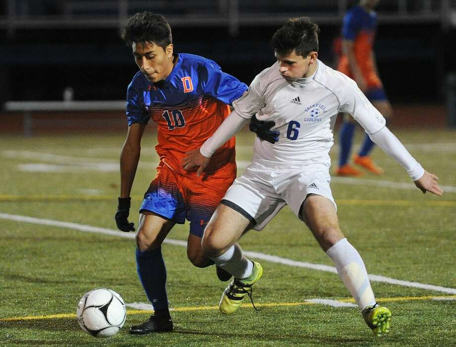 Danbury's Chriss Sari, left, battles for the ball with Fairfield Ludlowe's Max Goldring in the opening round of the Class LL Boys Soccer State Tournament at Ludlowe High School in Fairfield, Conn. on Monday, November 6, 2017. Photo: Brian A. Pounds / Hearst Connecticut Media / Connecticut Post
