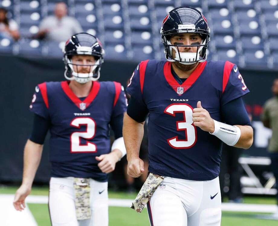 Houston Texans quarterback Tom Savage (3) and T.J. Yates run onto the field before an NFL football game at NRG Stadium on Sunday, Nov. 5, 2017, in Houston. ( Brett Coomer / Houston Chronicle ) Photo: Brett Coomer, Staff / © 2017 Houston Chronicle