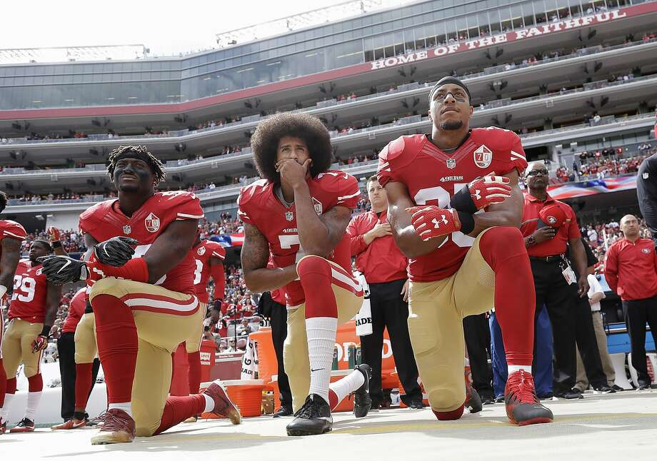 In this Oct. 2, 2016 file photo, from left, San Francisco 49ers outside linebacker Eli Harold, quarterback Colin Kaepernick and safety Eric Reid kneel in protest during the national anthem before an NFL football game against the Dallas Cowboys in Santa Clara, Calif.  Photo: Marcio Jose Sanchez / AP