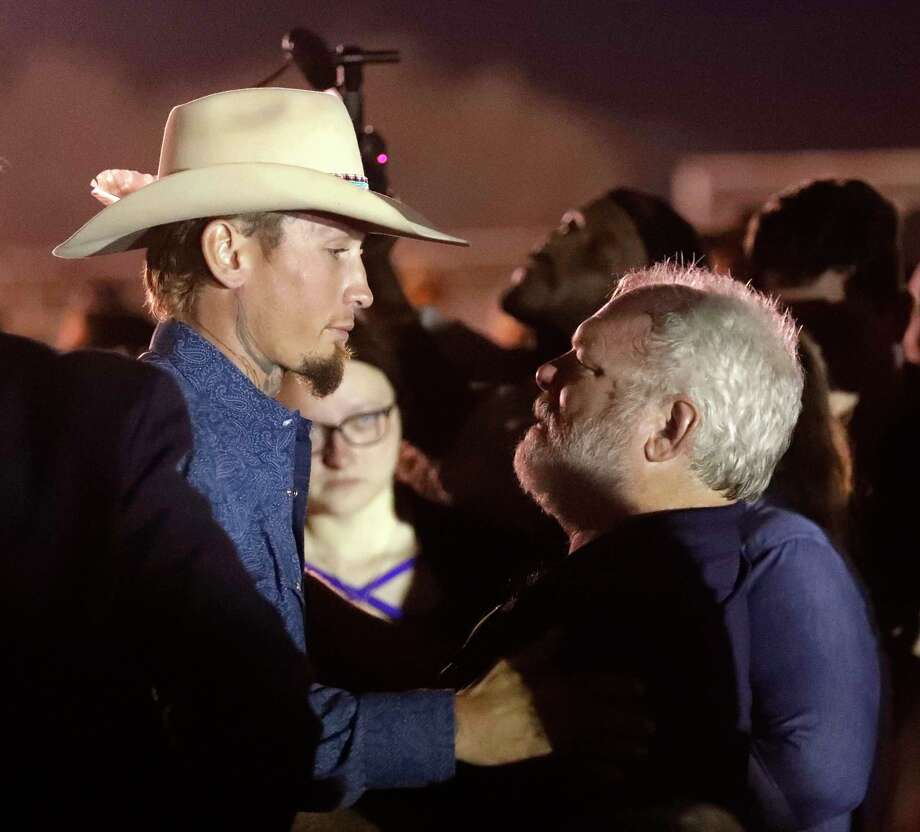 Stephen Willeford, right, hugs Johnnie Langendorff during a vigil for the victims of the First Baptist Church shooting Monday, Nov. 6, 2017, in Sutherland Springs, Texas. Willeford shot suspect Devin Patrick Kelley and Langendorff drove the truck while they chased Kelley. Kelley opened fire inside the church in the small South Texas community on Sunday, killing more than two dozen and injuring others. (AP Photo/David J. Phillip) Photo: David J. Phillip, Associated Press / Copyright 2017 The Associated Press. All rights reserved.