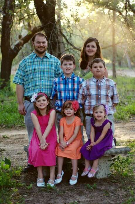 John Holcombe was wounded in the shooting, and his wife, Crystal Holcombe, who was pregnant, was killed, as were their children Emily Hill (front left), Megan Hill (front middle) and Greg Hill (right). Son Phillip (middle) was not in church, and daughter Evelyn (front right) was wounded. Photo: Courtesy Photo / COURTESY OF THE HOLCOMBE FAMILY