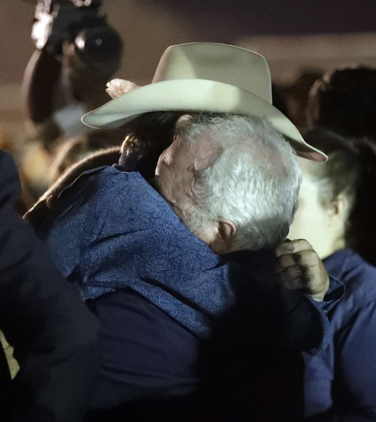 Stephen Willeford, right, hugs Johnnie Langendorff during a vigil for the victims of the First Baptist Church shooting Monday, Nov. 6, 2017, in Sutherland Springs, Texas. Willeford shot the suspect and Langendorff drove the truck while chasing Devin Patrick Kelley. Kelley opened fire inside the church in the small South Texas community on Sunday, killing more than two dozen and injuring others. (AP Photo/David J. Phillip)