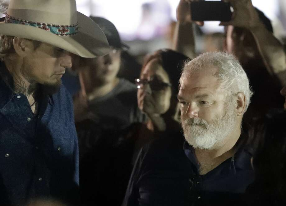 Stephen Willeford, right, and Johnnie Langendorff, left, attend a vigil for the victims of the First Baptist Church shooting Monday, Nov. 6, 2017, in Sutherland Springs, Texas. Willeford shot suspect Devin Patrick Kelley, and Langendorff drove the truck while chasing Kelley. Kelley had opened fire inside the church in the small South Texas community on Sunday, killing more than two dozen and injuring others. (AP Photo/David J. Phillip) Photo: David J. Phillip/Associated Press