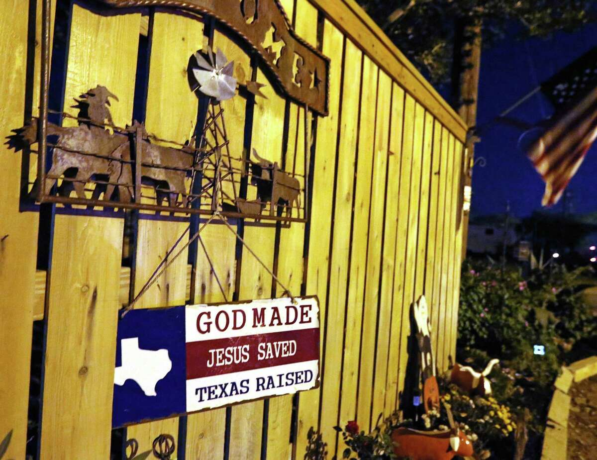 A look at the fence outside of Michael Ward's home in Sutherland Springs, Texas. At least 26 people died Sunday after a gunman opened fire at a Baptist church in the small town southeast of San Antonio. Photographed on Sunday, November 5, 2017. (Louis DeLuca/The Dallas Morning News/TNS) --MANDATORY CREDIT, TV OUT, MAGS OUT, NO SALES, INTERNET USE BY TNS MEMBERS ONLY