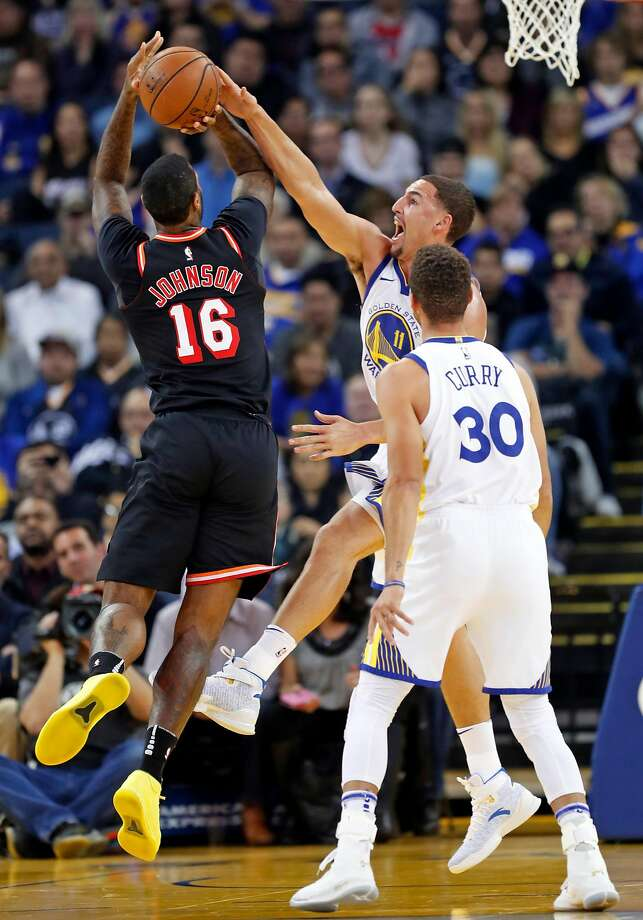 Golden State Warriors' Klay Thompson blocks a shot by Miami Heat's James Johnson in 1st quarter during NBA game at Oracle Arena in Oakland, Calif., on Monday, November 6, 2017. Photo: Scott Strazzante, The Chronicle