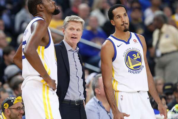 7eb3f64245c6 1of5Golden State Warriors  head coach Steve Kerr is flanked by Kevin Durant  and Shaun Livingston during a stoppage of play during 2nd quarter against  Miami ...