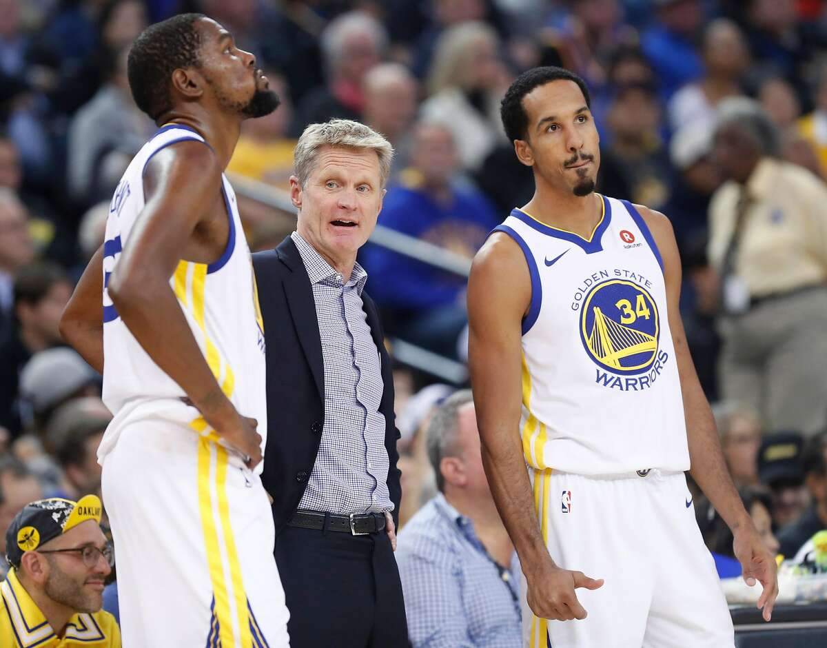 Golden State Warriors' head coach Steve Kerr is flanked by Kevin Durant and Shaun Livingston during a stoppage of play during 2nd quarter against Miami Heat during NBA game at Oracle Arena in Oakland, Calif., on Monday, November 6, 2017.