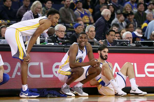 Golden State Warriors' Patrick McCaw, Kevon Looney and Omri Casspi wait to enter game in 4th quarter against Miami Heat during Warriors' 97-80 win in NBA game at Oracle Arena in Oakland, Calif., on Monday, November 6, 2017.