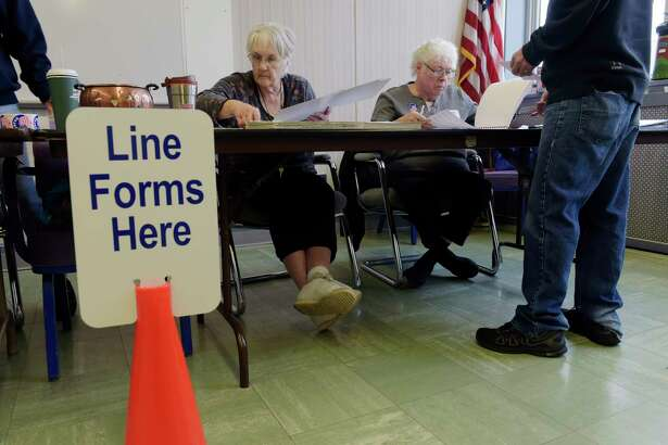 Election inspectors, Jackie Morgan, left, and Pauline Letzelter work at the polling station inside Rensselaer City Hall on Tuesday morning, Nov. 7, 2017, in Rensselaer, N.Y.   (Paul Buckowski / Times Union)