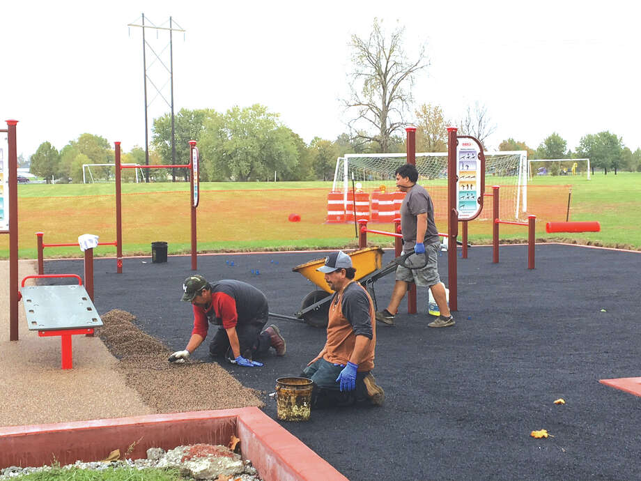Crews work on the exercise and fitness area at Drost Park in Maryville. Photo: John Sommerhof • Jsommerhof@edwpub.net