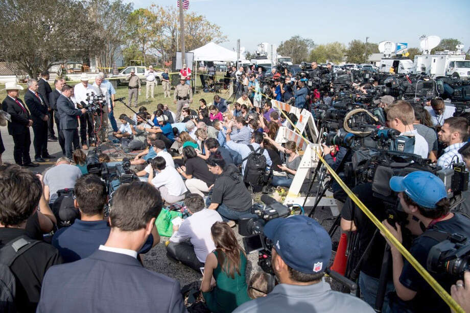 "Reporters attend a news conference outside the First Baptist Church in Sutherland Springs, Texas. A congressman had earlier named the shooter as ""Sam Hyde"" - a figment of the internet. Photo: Washington Post Photo By Carolyn Van Houten / The Washington Post"