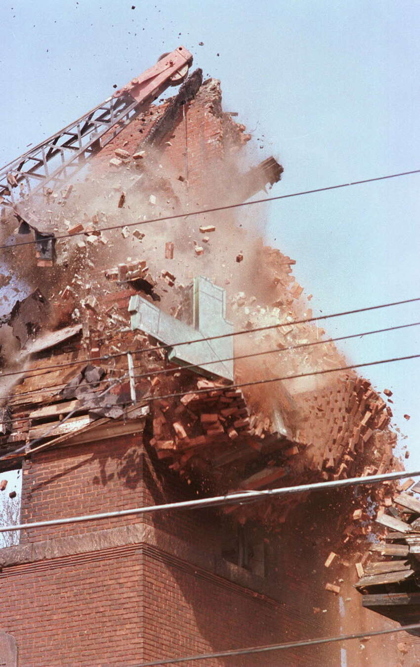 Times Union photo by LUANNE M. FERRIS -- THURSDAY, MAY 8, 1997, TROY, DEMOLITION OF OF THE ST. PAUL'S MISSIONARY BAPTIST CHURCH ON SIXTH AVE IN TROY. THE CHURCH AND THE RECTORY CAUGHT FIRE ON TUESDAY, TOTALLY DESTROYING BOTH STRUCTURES.