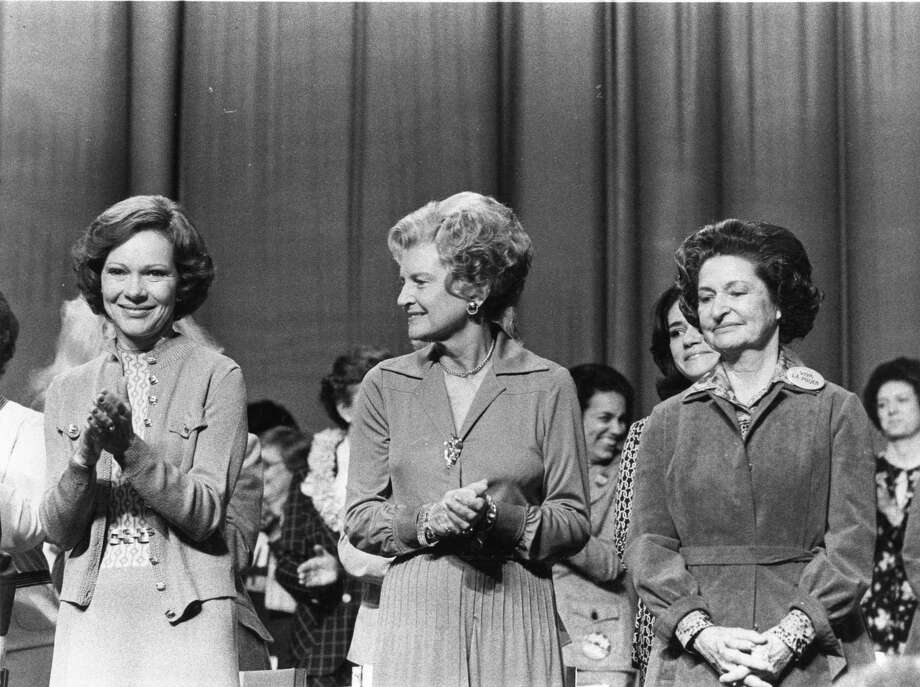 First Lady Rosalynn Carter and former first ladies Betty Ford and Lady Bird Johnson on stage at the opening of the National Women's Conference. Photo: Sam C. Pierson Jr., Houston Chronicle / Houston Chronicle