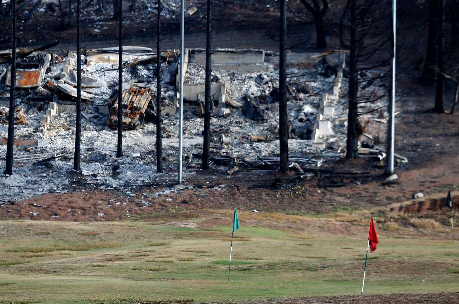 A home destroyed by fire is seen behind the driving range at the Fountaingrove Golf Club in Santa Rosa, Calif. on Thursday, Nov. 2, 2017. Fountaingrove hopes to reopen the course in mid-November despite its clubhouse and other buildings getting burned to the ground in last month's Tubbs Fire. Photo: Paul Chinn, The Chronicle