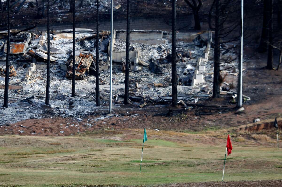 A home destroyed by fire is seen behind the driving range at the Fountaingrove Golf Club in Santa Rosa, Calif. on Thursday, Nov. 2, 2017. Fountaingrove hopes to reopen the course in mid-November despite its clubhouse and other buildings getting burned to the ground in last month's Tubbs Fire.