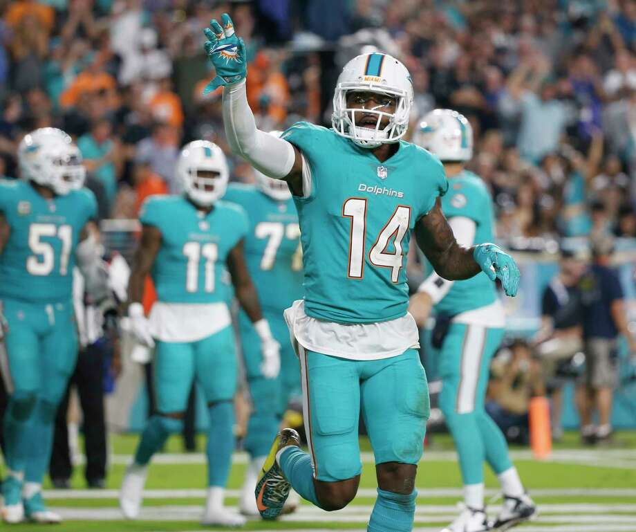 Miami Dolphins wide receiver Jarvis Landry (14) waves to fans after scoring a touchdown, during the second half of an NFL football game against the Oakland Raiders, Sunday, Nov. 5, 2017, in Miami Gardens, Fla. (AP Photo/Wilfredo Lee) Photo: Wilfredo Lee, Associated Press / Copyright 2017 The Associated Press. All rights reserved.