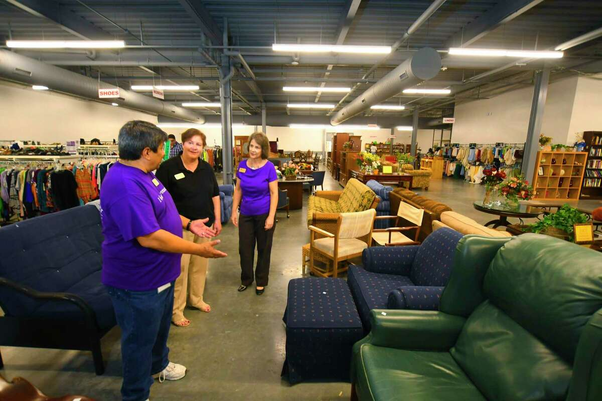 Northwest Assistance Ministries assistant Abel Garcia, left, NAM CEO Carole Little and NAM assistant Denese Hammon view items. Despite being delayed for nearly a month due to Hurricane Harvey, the Northwest Assistance Ministries opened its resale shop at a new location in north Houston Nov. 3. The new $5.3 million, two-story Harrell Family Opportunity Center, located behind NAM's main building, broke ground in August 2016 and was officially opened in June.
