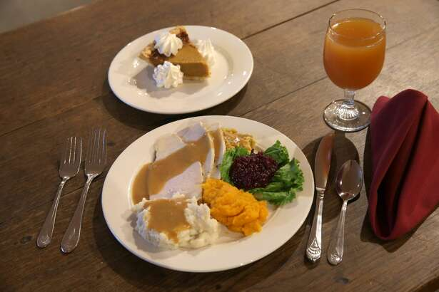 PLYMOUTH, MA - NOVEMBER 24: Turkey dinner on an antique styled table. About 4,000 lbs of turkey, 350 pies, 4,500 dinner rolls are served at Plimouth Plantation on Thanksgiving. (Photo by David L. Ryan/The Boston Globe via Getty Images)