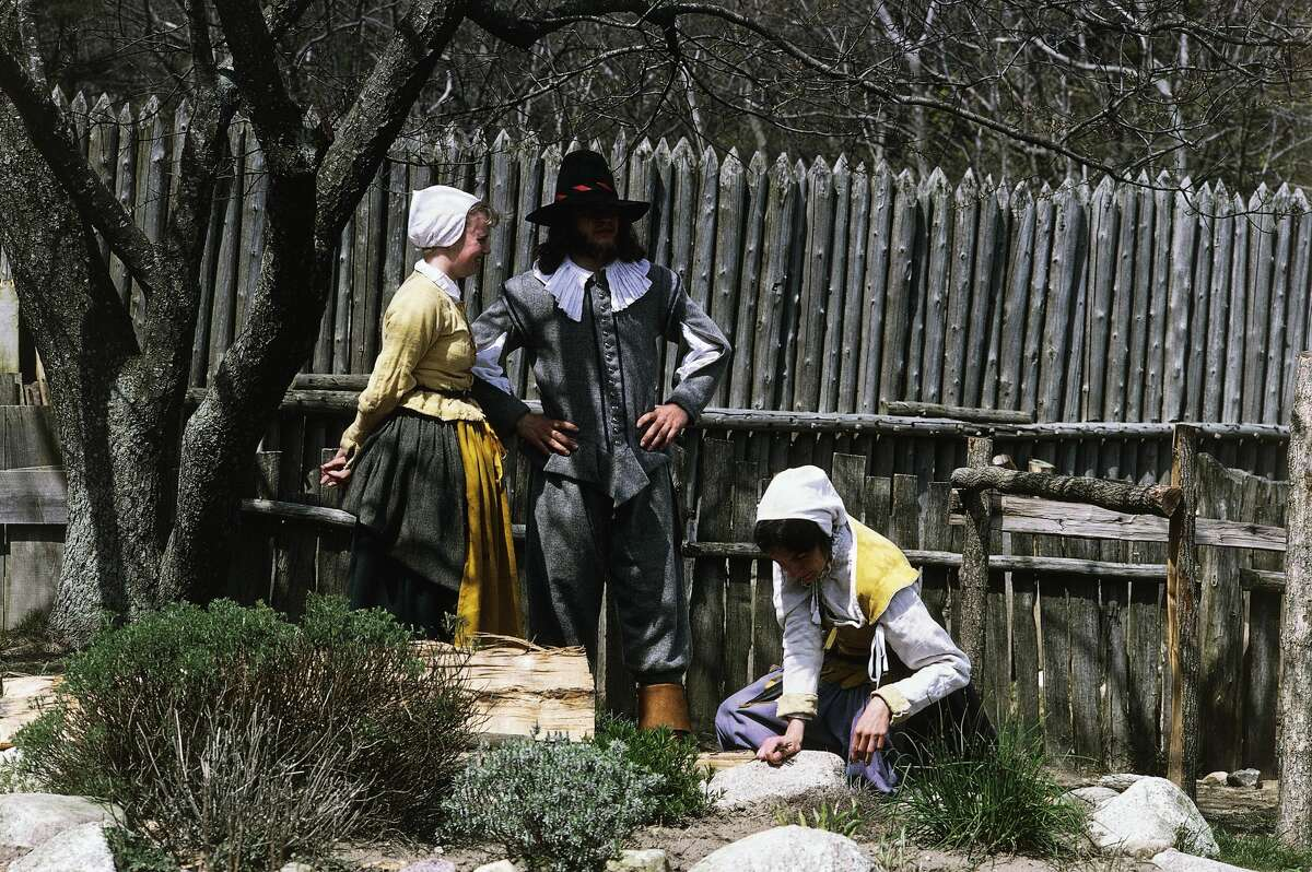Actors at the Plimoth Plantation reenact the first meeting between the pilgrims and native Americans in Plymouth Town, Massachusetts.