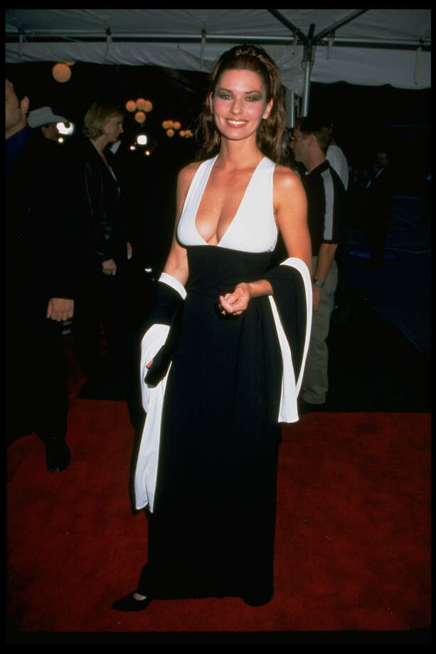 Country music superstar Shania Twain wearing a black & white gown with a plunging neckline by designer Marc Bouwer, walking on the red carpet while arriving at the 32nd annual Country Music Association Awards.  (Photo by Tammie Arroyo/The LIFE Images Collection/Getty Images) Photo: Tammie Arroyo/The LIFE Images Collection/Getty Images