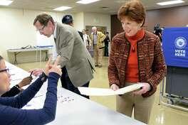 Mayor Kathy Sheehan and husband Robert get their ballots at B'Nai Shalom Tuesday Nov. 7, 2017 in Albany, NY.  (John Carl D'Annibale / Times Union)