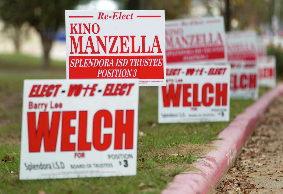 Campaign signs for Splendora ISD School Board candidates Kino Manzella and Barry Welch are seen outside a polling location on Election Day, Tuesday, Nov. 7, 2017, in Splendora.