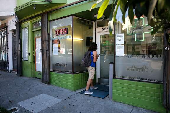 Mission Organic Center, a cannabis store is a few doors down from the El Pollo Supremo restaurant along Mission St. near Geneva in San Francisco, Ca. as seen on Thurs. Sept. 28, 2017.