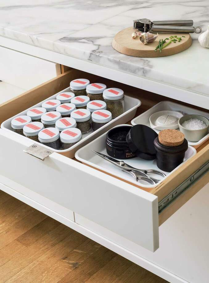 Editors at Remodelista.com suggest creating a spice drawer to keep these cooking necessities together. Label them on top for easy identification.  Photo: Matthew Williams / ©Matthew Williams