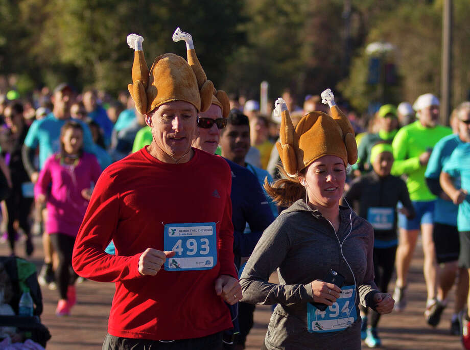 Runners sport Thanksgiving themed hats as they take part in the annual GE Run Thru the Woodlands Thursday, Nov. 24, 2016, in The Woodlands. The event raised money for the YMCA as well as other local charities. Photo: Jason Fochtman, Staff Photographer / Houston Chronicle