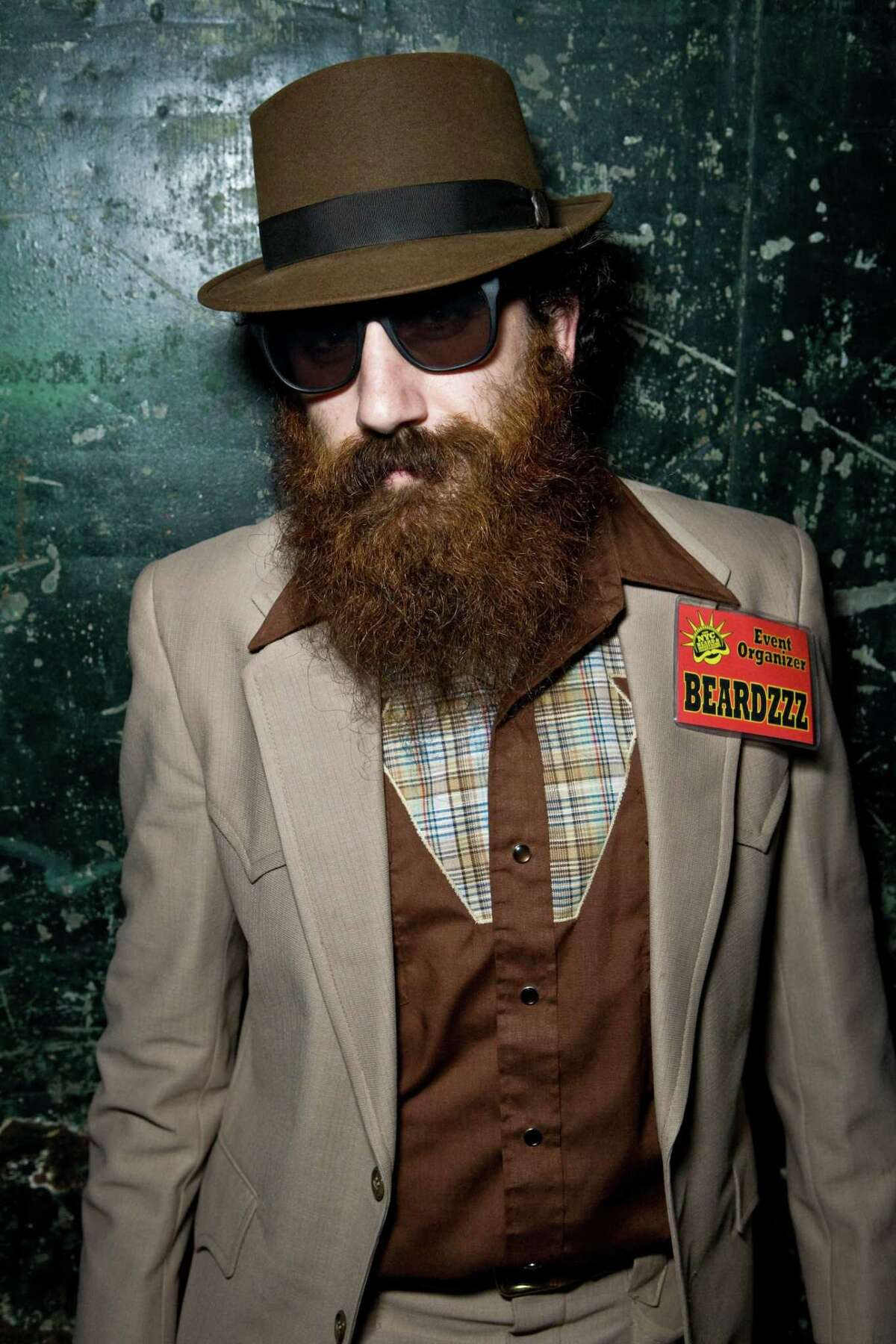 """Like the hipster, lumberjack-metrosexual look? Wear a trilby. Yes, the trilby skews trendy, mostly because you see it with so many skinny jeans. That said, the trilby looks much more hip than hipster when paired with a sharp suit, cardigan, or turtleneck. Vests look good with trilbies as well, provided you don't mind the Mumford & Sons comparisons. Bow-tie wearers wear it well with a trilby, too. The trilby usually has a taller crown, wider band and narrower brim than the fedora. Trilby style icons include Don Draper in """"Mad Men"""" and the late Leonard Cohen."""