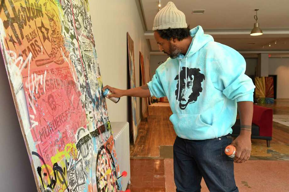 "Jahmane works on his artwork, ""Mentalchemy 25,"" for the first show at the new urban art gallery Blends in downtown Bridgeport. Photo: Bradley E. Clift / For Hearst Connecticut Media / All images produced are owned by Bradley E. Clift  © 2017  Any use beyond Hearst Media must have written permission from copyrig"