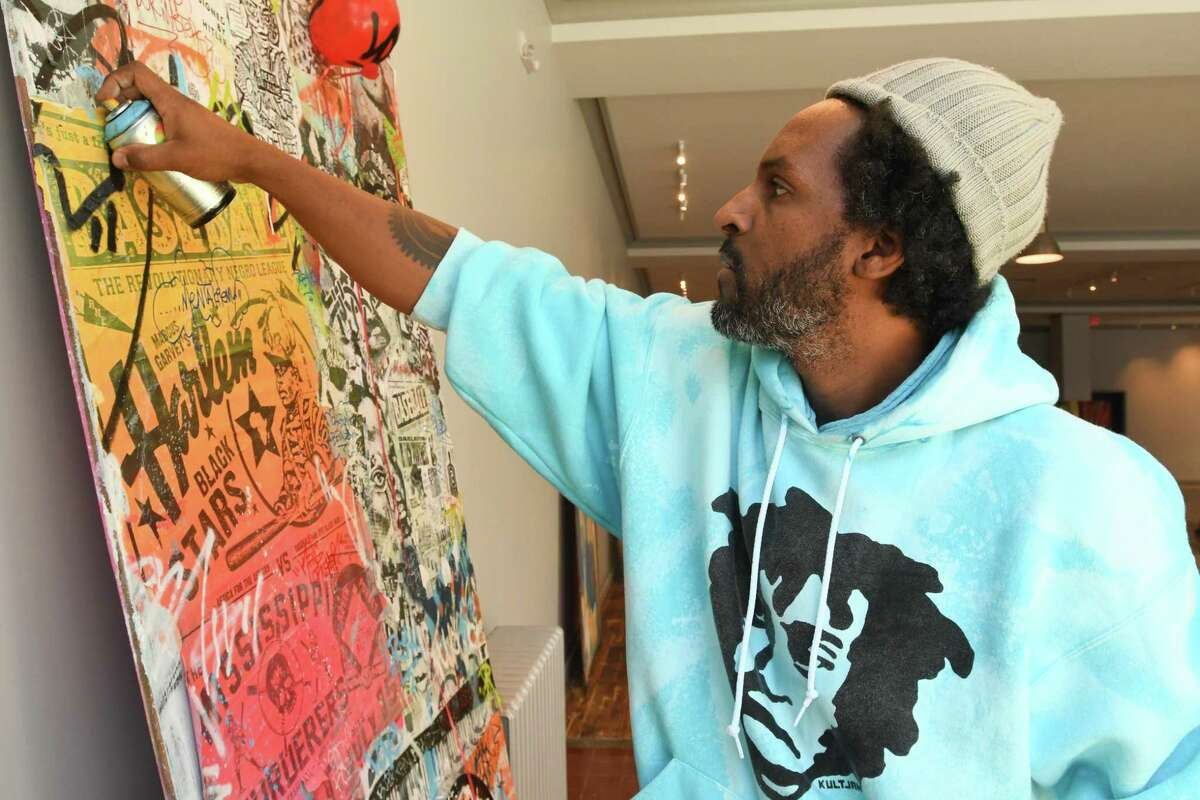 Jahmane works on a piece for the Blends Gallery's opening show.