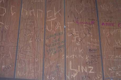 The walls at Rawley's are scribbled with graffiti (both new and vintage). Photo: Jane Stern / For Hearst Connecticut Media