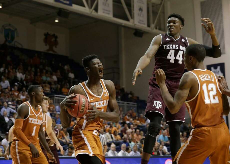Texas forward Mohamed Bamba (4) reacts after a rebound, defended by Texas A&M forward Robert Williams (44) in an exhibition game in Houston on Oct. 25, 2017. Photo: Tim Warner /Houston Chronicle