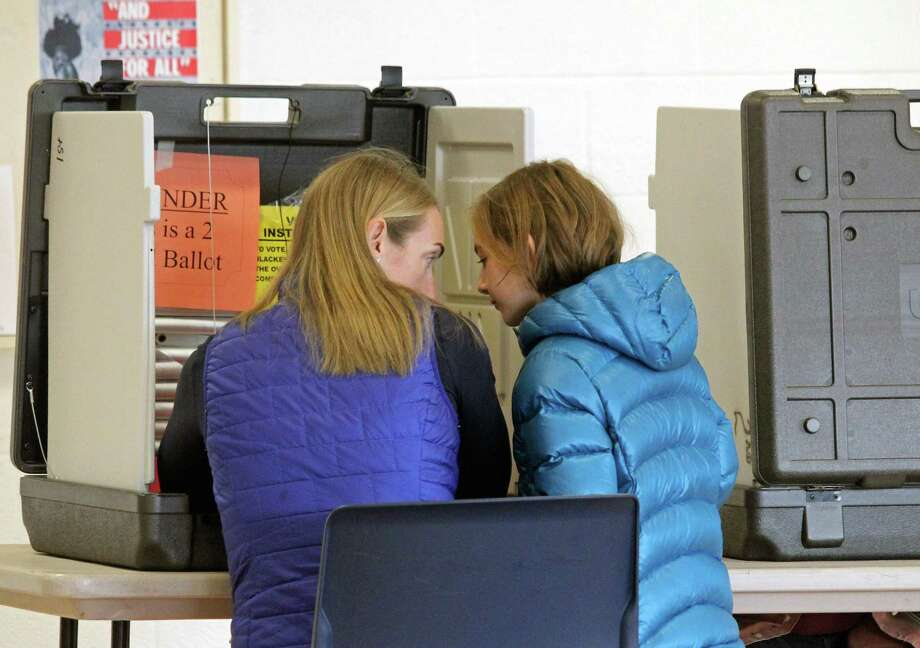 "Voting at Fairfield Ludlowe High School Tuesday morning was called ""steady"" by poll workers. This year, there is no first selectman race on the ballot. Photo: Genevieve Reilly / Hearst Connecticut Media / Fairfield Citizen"