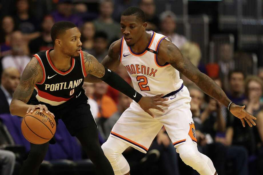 PHOENIX, AZ - OCTOBER 18:  Damian Lillard #0 of the Portland Trail Blazers handles the ball against Eric Bledsoe #2 of the Phoenix Suns during the first half of the NBA game at Talking Stick Resort Arena on October 18, 2017 in Phoenix, Arizona.  NOTE TO USER: User expressly acknowledges and agrees that, by downloading and or using this photograph, User is consenting to the terms and conditions of the Getty Images License Agreement. Photo: Christian Petersen, Getty Images / 2017 Getty Images