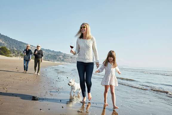 Zoe Johns, left, vintner and president of Turnbull Wines, walks with daughter, Josephine, on Thursday, Nov. 2, 2017 in Stinson Beach, Calif.