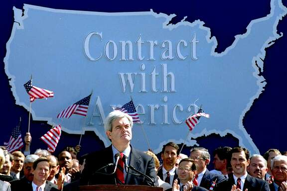 "Then House Minority Whip Rep. Newt Gingrich, D-Ga., addresses Republican congressional candidates on Capitol Hill in this Sept. 27, 1994, file photo during a rally where they pledged a ""Contract with America."" (AP Photo/John Duricka, File)"