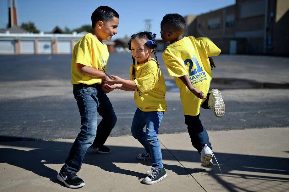 Amanda Guebara's kindergarten class honored their classmate Lilly Orosco on Oct. 31, 2017, for Down Syndrome Awareness Month at St. Anne's School. James Durbin/Reporter-Telegram Photo: James Durbin