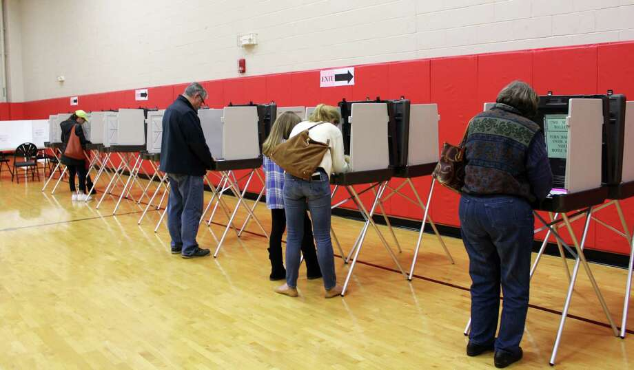 Voters cast their ballots for the local elections  in New Canaan, Conn. at New Canaan High School on Nov. 7, 2017. Photo: Erin Kayata / Hearst Connecticut Media / New Canaan News