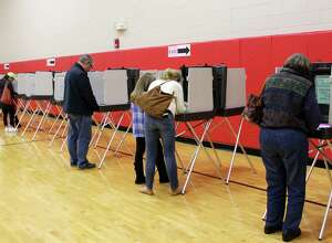 Voters cast their ballots for the local elections  in New Canaan, Conn. at New Canaan High School on Nov. 7, 2017.