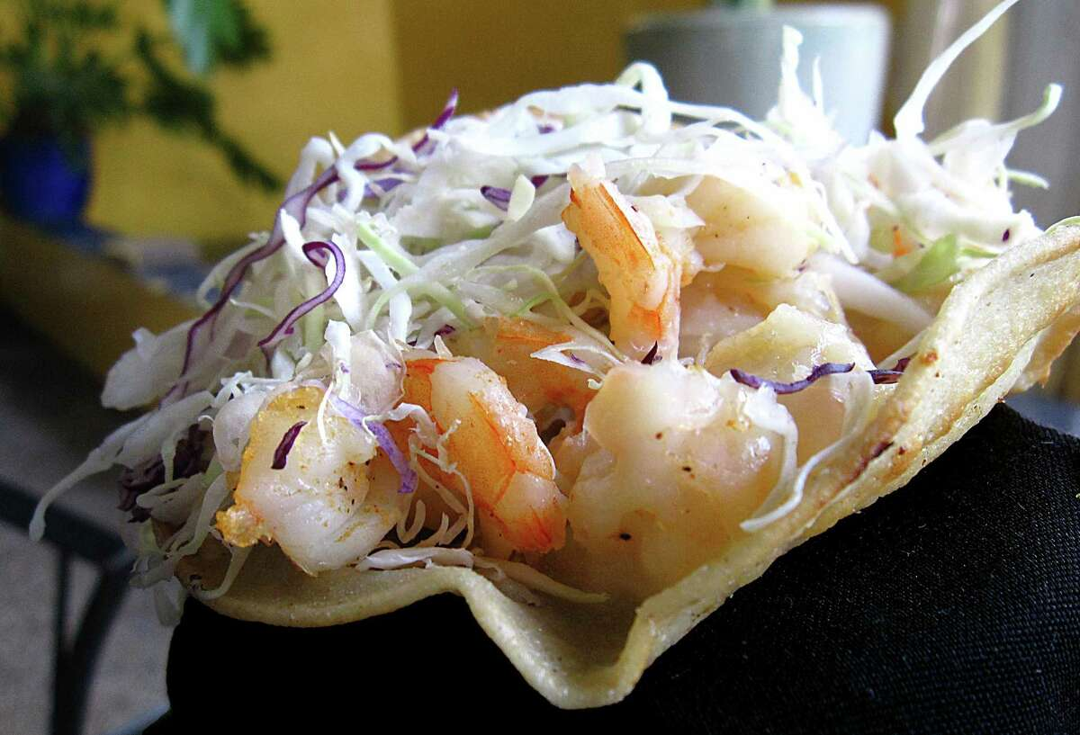 Shrimp taco with cheese and cabbage on a handmade corn tortilla from El Mirasol.