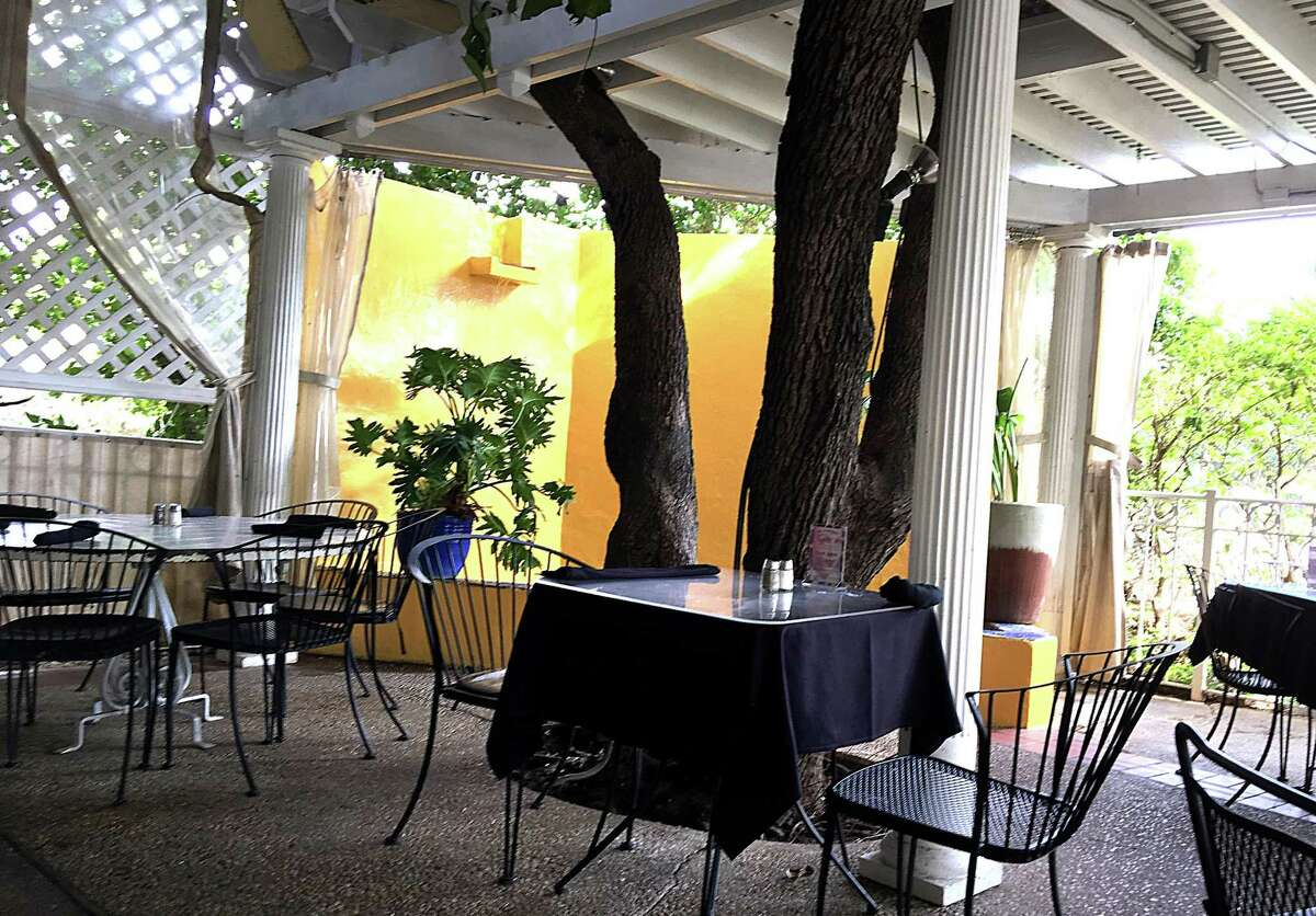 A covered patio with a waterfall at El Mirasol on Blanco Road
