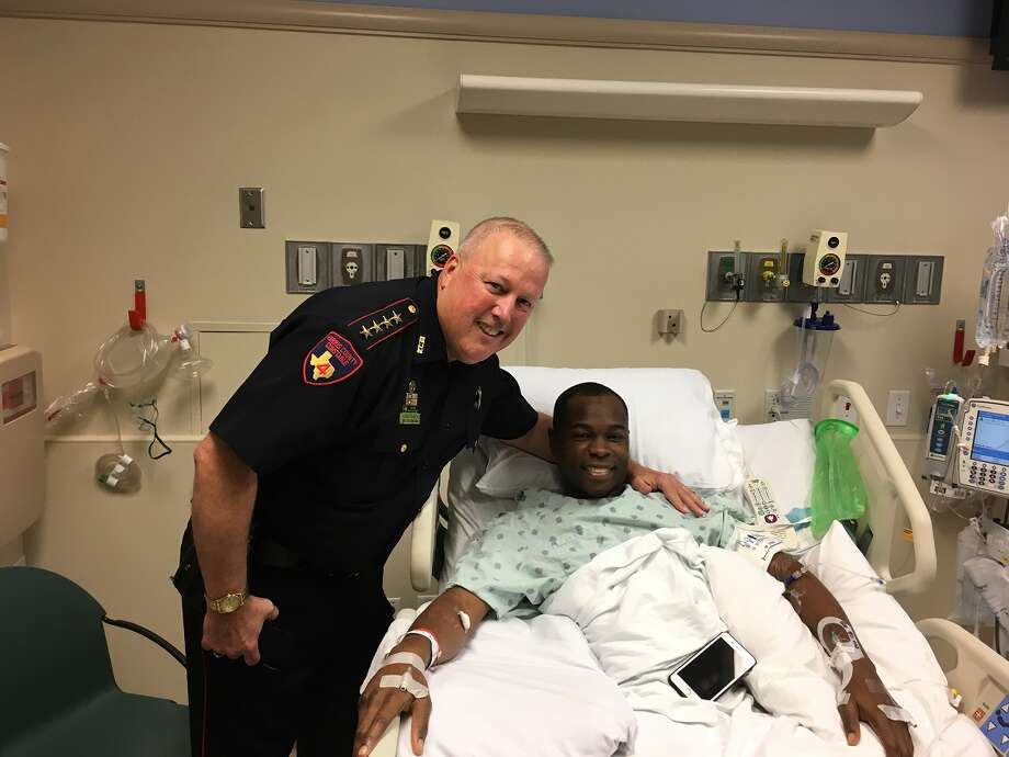 Harris County Pct. 4 Constable Mark Herman visited with Deputy Justin Gay, who was shot Sunday, on Tuesday morning. Photo: Harris County Constable Pct. 4