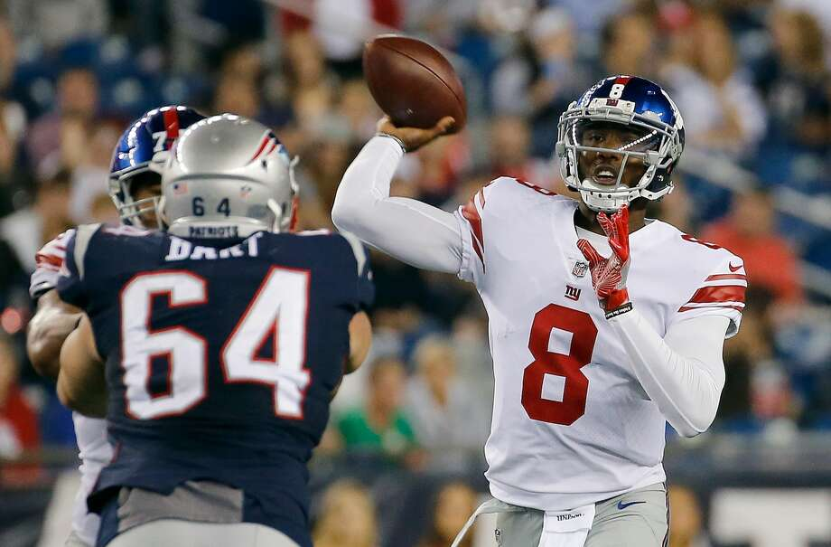 FOXBORO, MA - AUGUST 31: Josh Johnson #8 of the New York Giants throws over Michael Bart #64 of the New England Patriots in the first half during a preseason game at Gillette Stadium on August 31, 2017 in Foxboro, Massachusetts. (Photo by Jim Rogash/Getty Images) Photo: Jim Rogash/Getty Images