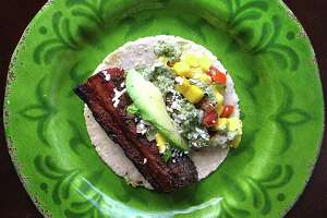 Taco of the Week: Pork belly taco with mango pico de gallo on a handmade corn tortilla from Sangria on the Burg.