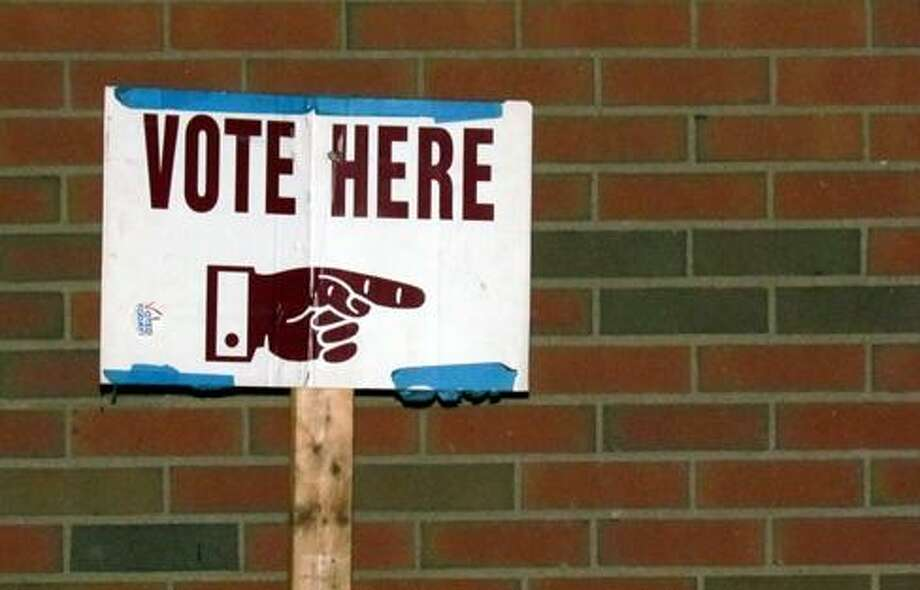 Vote here sign Photo: CTNewsJunkie File Photo / CTNewsJunkie File Photo