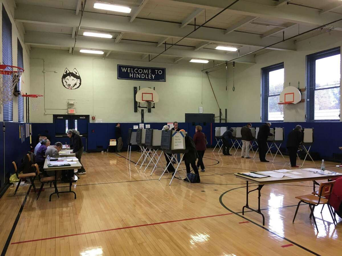 Voting takes place at Hindley Elementary School in Darien in this file photo.